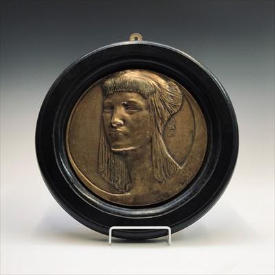 Lot 10-An Art Deco period circular brass plaque after...