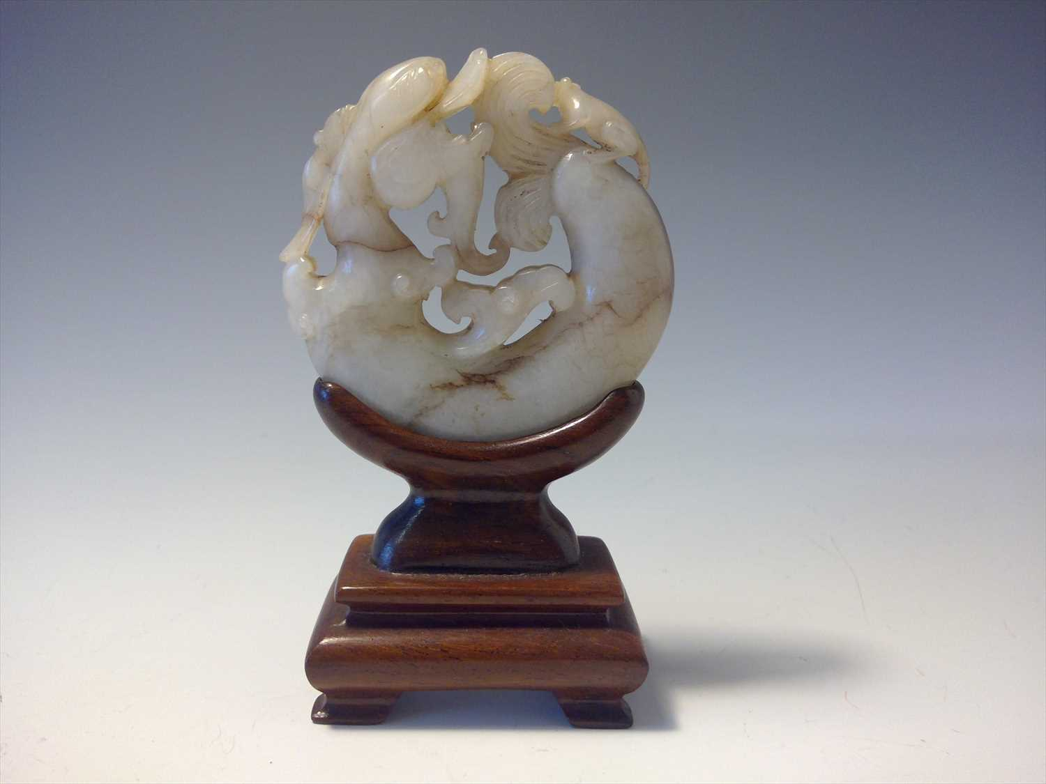 Lot 19-A Chinese circular jade carving of a dragon and...
