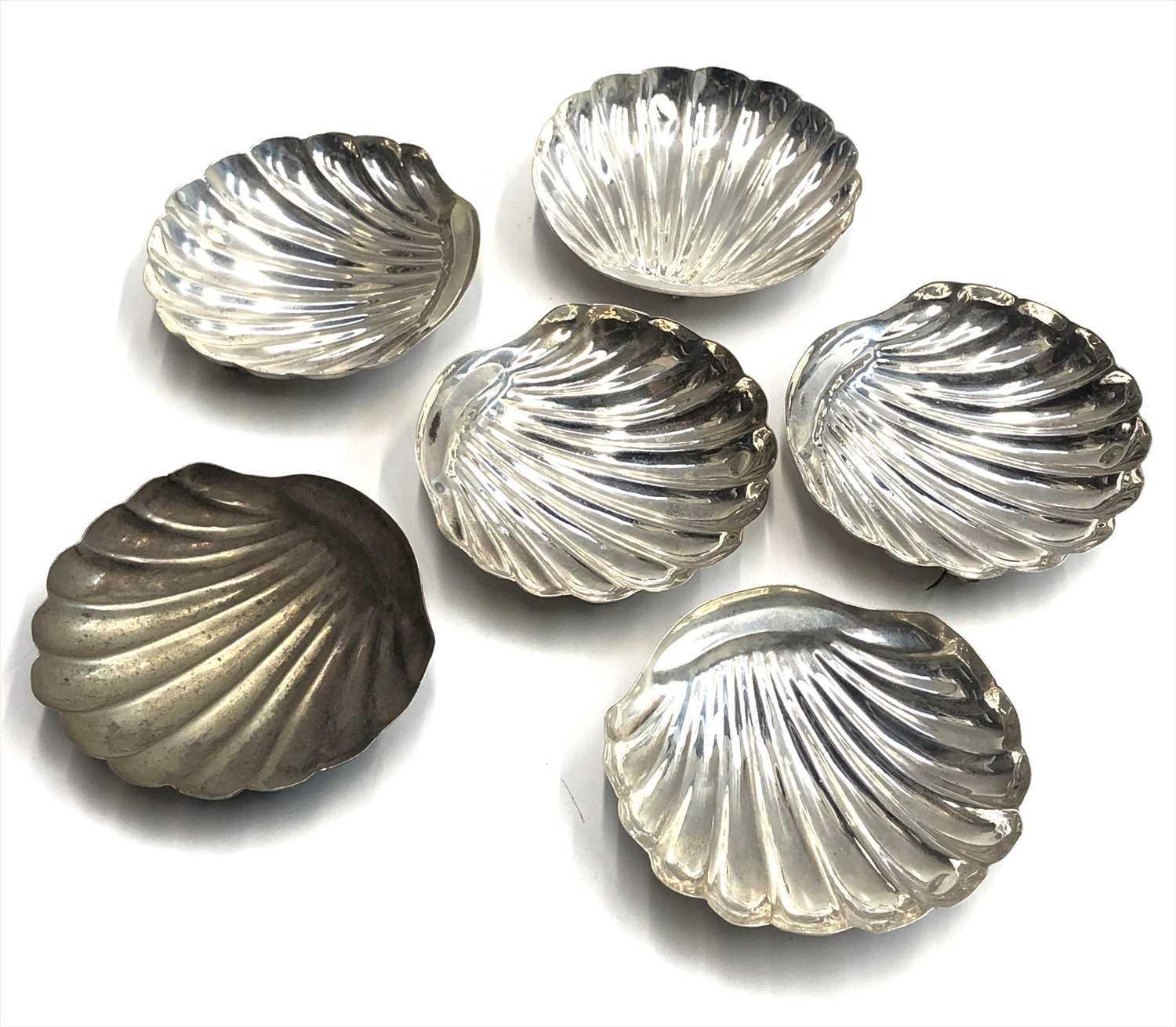 Lot 48-A set of six Egyptian silver scallop shaped...
