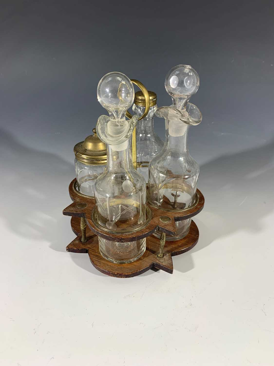 Lot 14-A Georgian style four bottle cruet with brass and ...