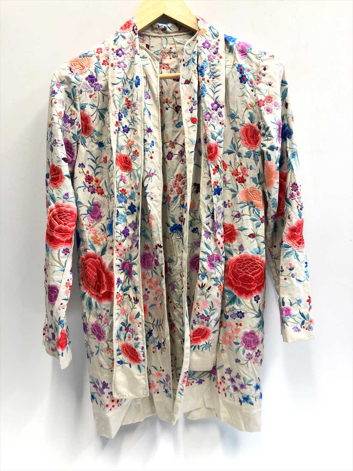 Lot 14-A Chinese silk embroidered lady's cream jacket,...