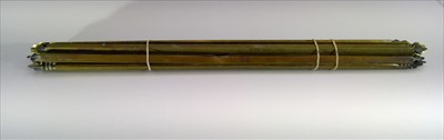 Lot 33-A set of 14 brass stair rods. Width 68cm.
