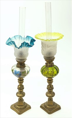 Lot 34-Two glass and brass oil lamps, surmounted on a...