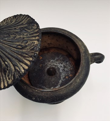 Lot 6-An early 20th century cast iron lidded urn.Height ...