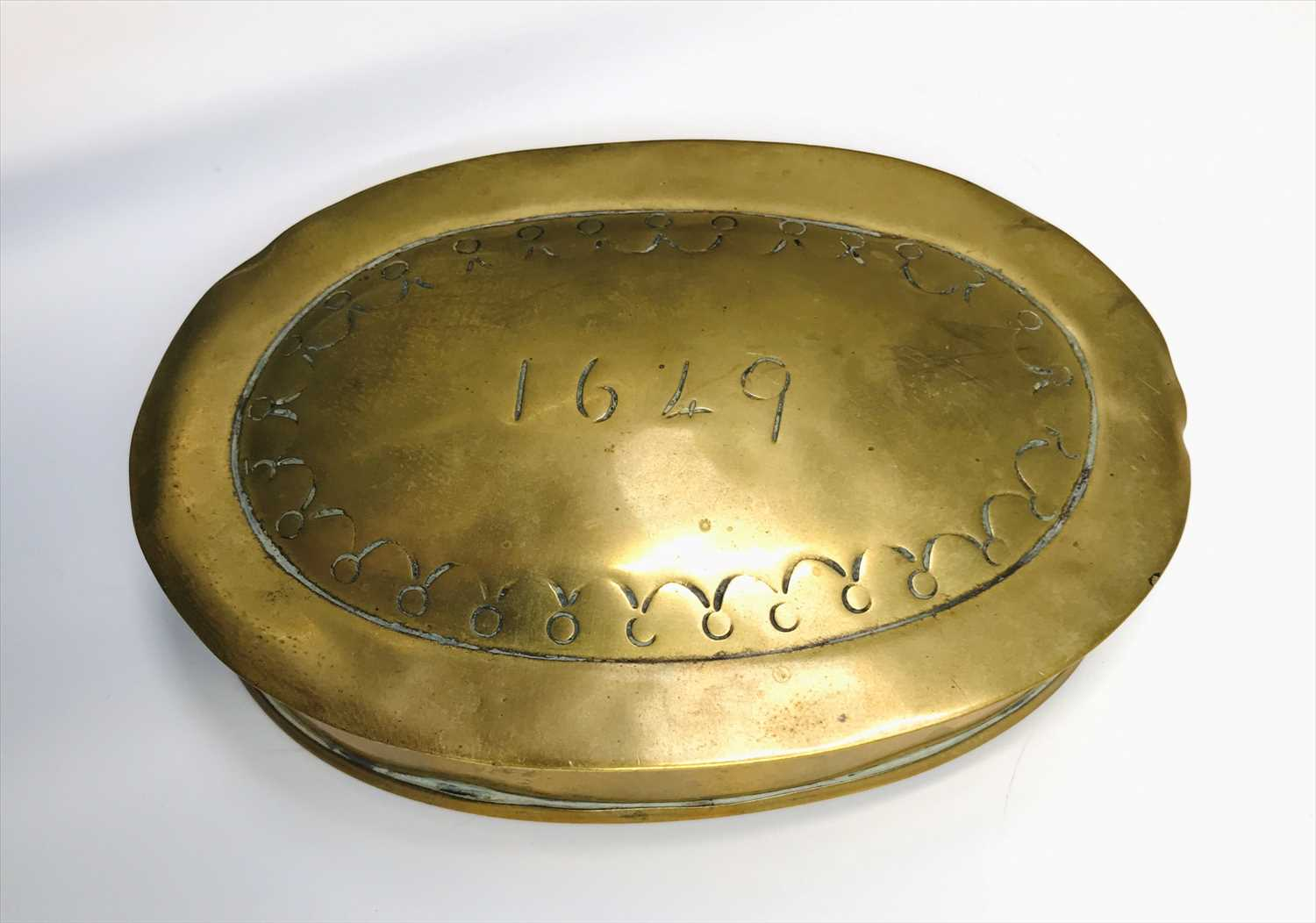 Lot 13-A brass tobacco box of oval form, inscribed 1649. ...
