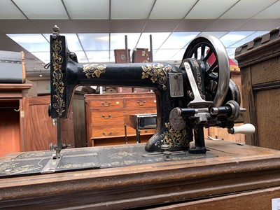 Lot 8-A hand crank sewing machine by Winselmann, in...