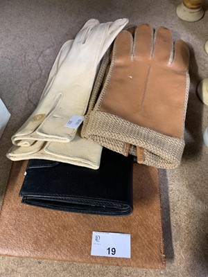 Lot 19-Two leather wallets and two pairs of gloves.