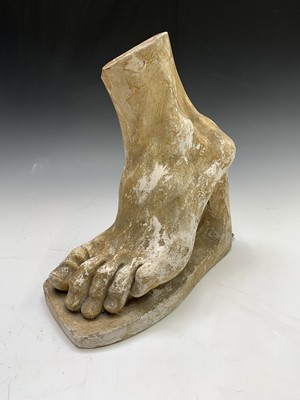Lot 2-A plaster cast sculpture of a foot, after the...