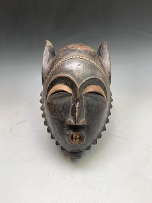 Lot 20-An African carved wood and painted tribal mask,...