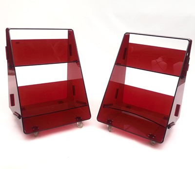 Lot 5-A pair of red acrylic library book caddies by...