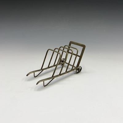 Lot 6-An unusual EPNS toast or letter rack, shaped...