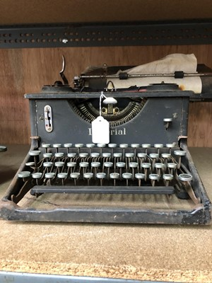 Lot 9-A vintage Imperial Typewriter.