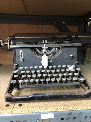 Lot 10-A vintage Imperial typewriter.
