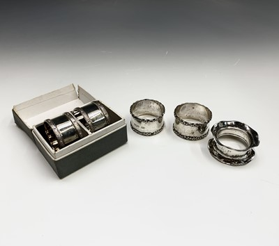 Lot 6-Two pairs of silver napkin rings and a fifth...