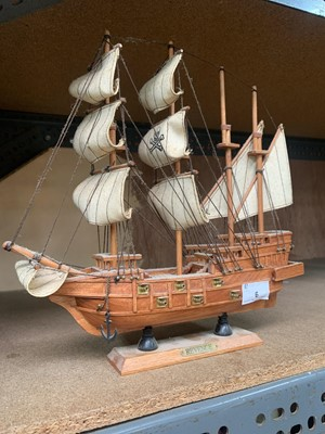 Lot 6-A small wooden model boat.