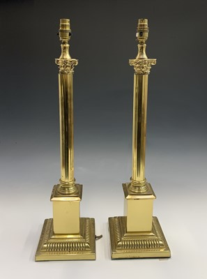 Lot 15-A pair of brass effect corinthian column table...