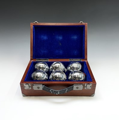 Lot 14-A set of chrome boules, with jack in a wooden...
