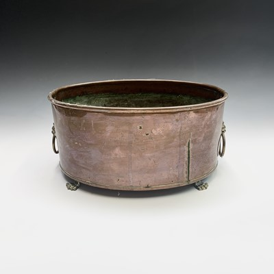Lot 4-A copper plant trough of oval form, with brass...