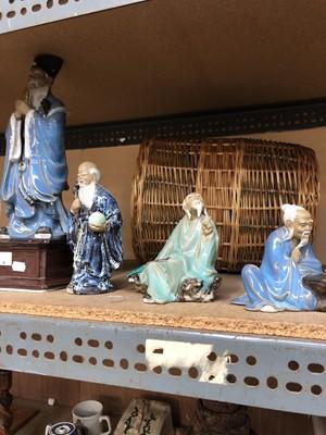 Lot 4-Four oriental figurines, including a figurine...