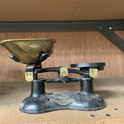 Lot 10-Two sets of vintage weighing scales.