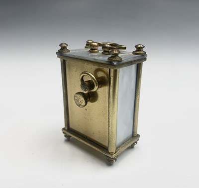 Lot 20 - A French miniature alarm clock, with dummy...