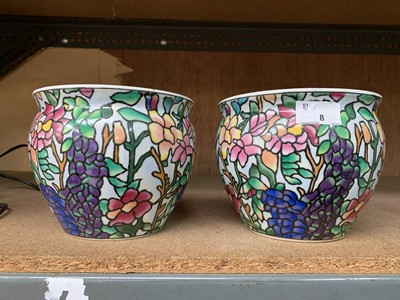 Lot 8-Two colourfully decorated Chinese plant pots.
