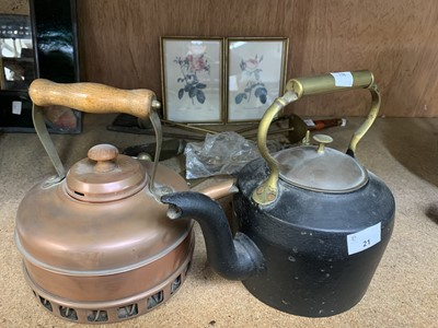 Lot 21-A cast iron kettle, together with a copper...