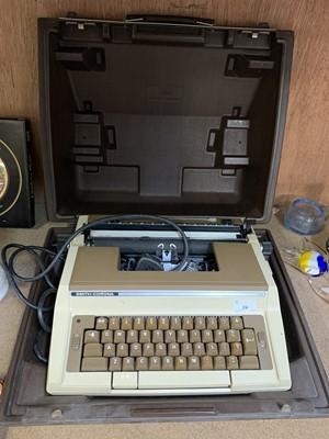 Lot 24-A cased Smith Corona C420 typewriter.