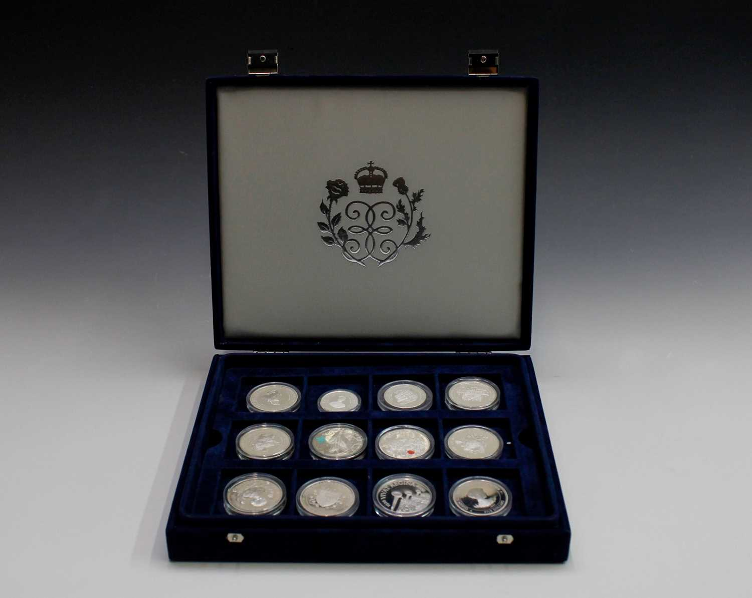 Lot 16-Silver proof coins - 14 crown size including...