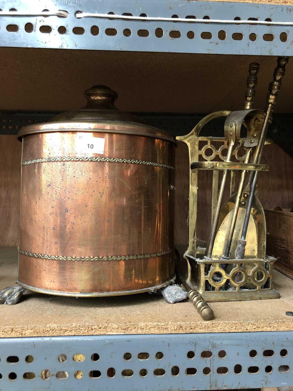 Lot 10 - A brass coal bin and companion set.