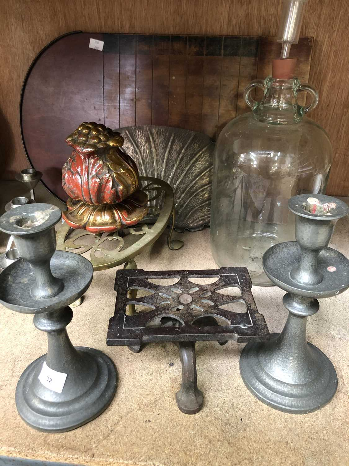 Lot 32 - Two 'Unity' English pewter candlesticks,...