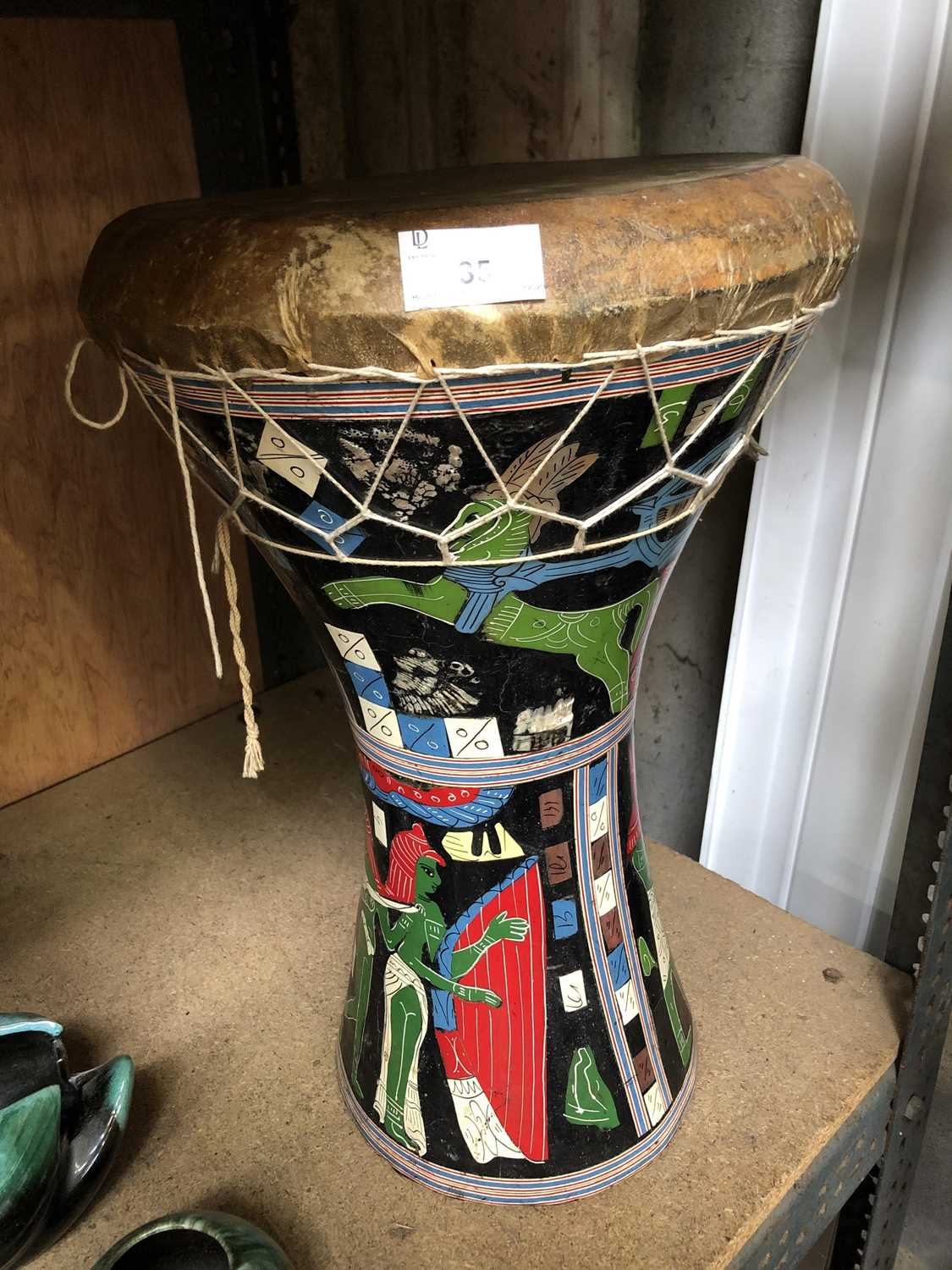 Lot 35 - A hand painted African drum.