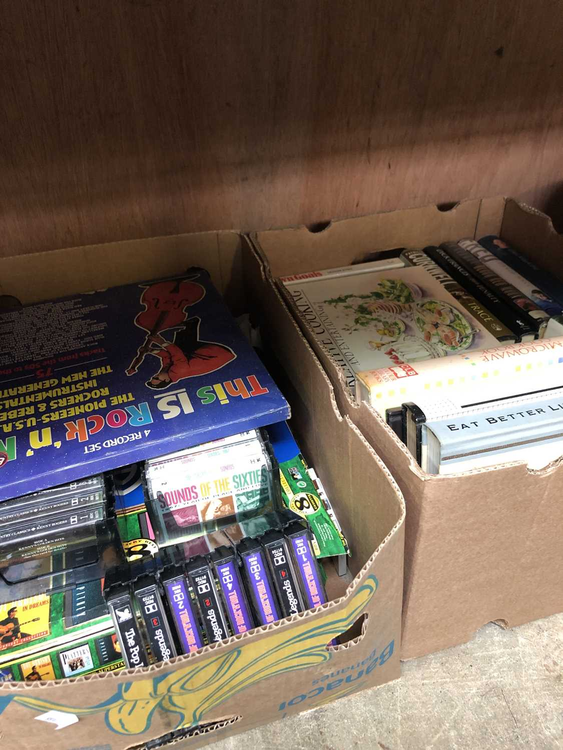 Lot 37 - A box of vintage cassettes and a box of books.