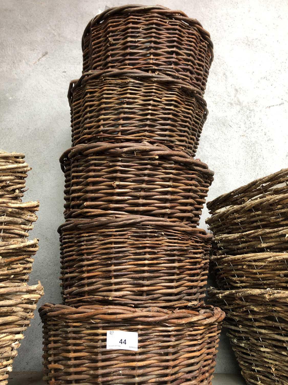 Lot 44 - Five circular wicker baskets, each containing...