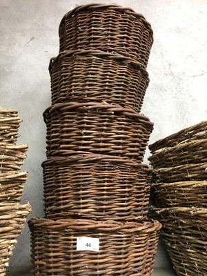 Lot 44 - Five circular wicker baskets, each containing...