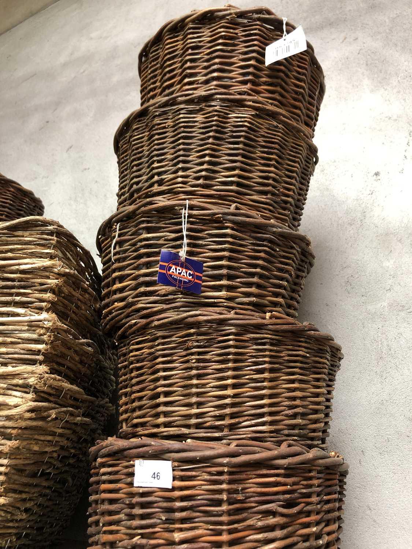 Lot 46 - Five circular wicker baskets, each containing...