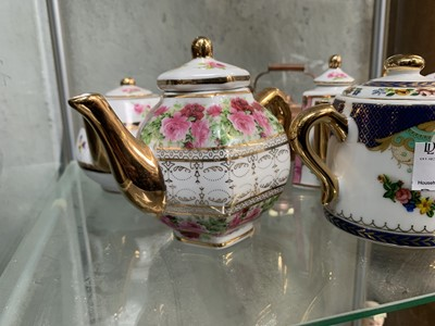 Lot 62 - Miniature porcelain teapots etc