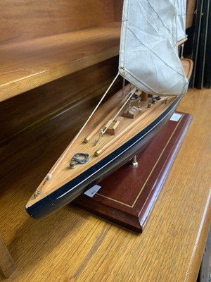 Lot 72 - Wood model of a yacht on a stand.