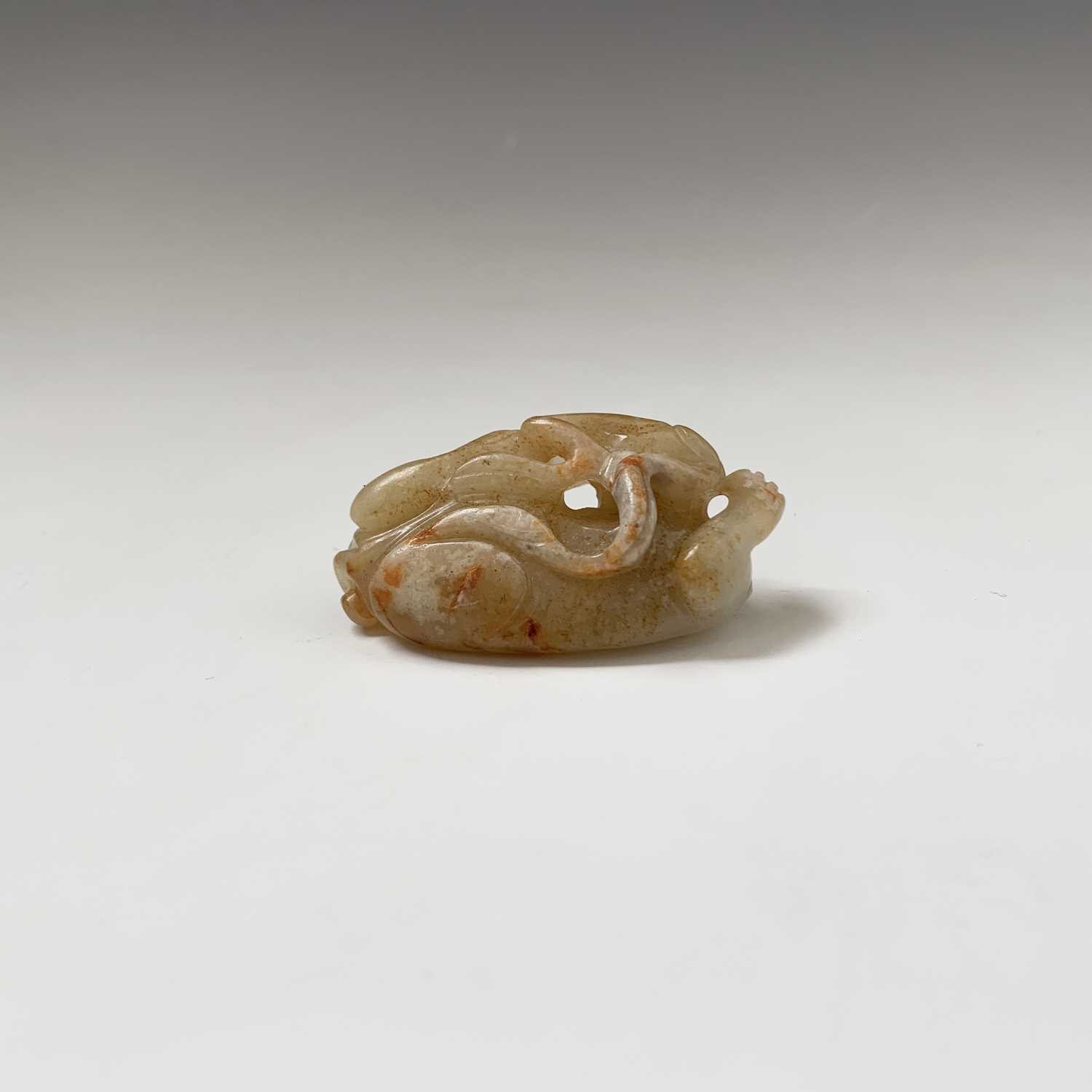Lot 21-A Chinese carved jade figure of a feline, with...