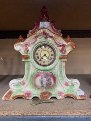 Lot 3 - A ceramic mantle clock, indistinct markings to...