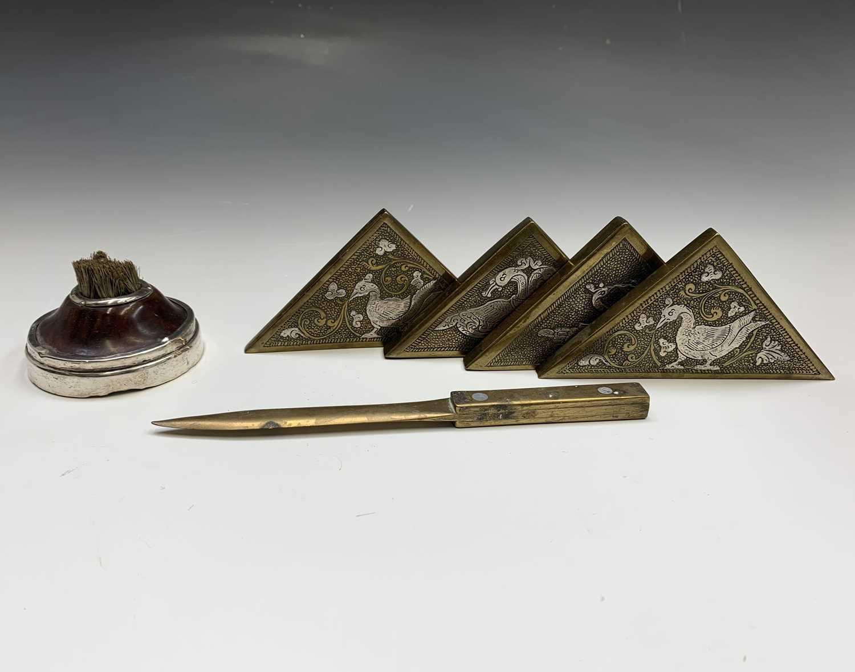 Lot 1083 - A silver-mounted nib brush, a set of four Sri...