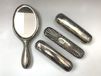 Lot 36-A silver-mounted mirror and three...
