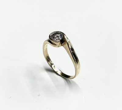 Lot 55 - An 18ct gold diamond solitaire contemporary...