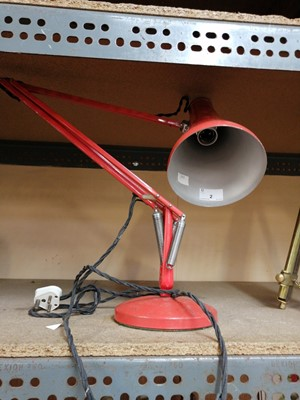 Lot 2-An orange 'Herbert Terry' anglepoise lamp.