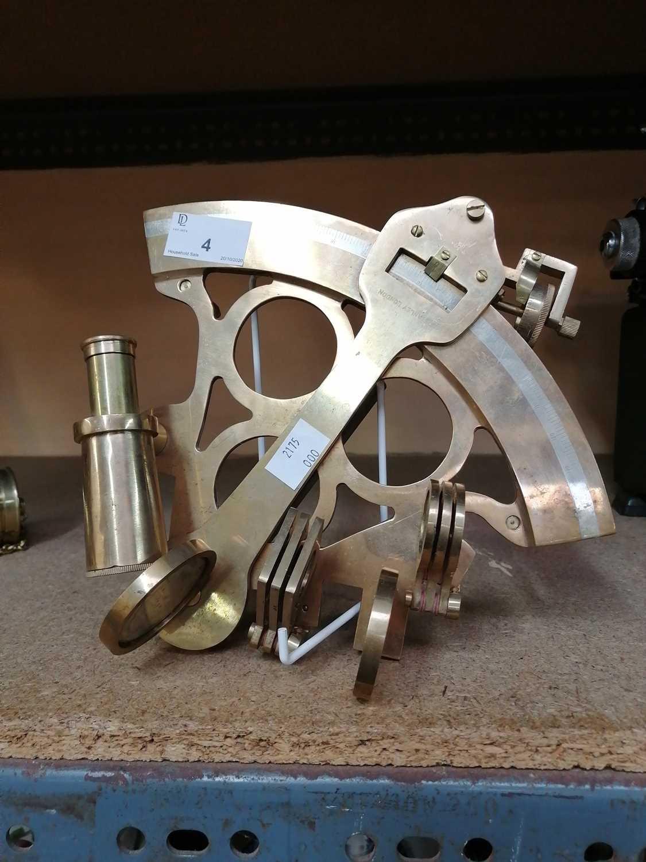 Lot 4-A brass sextant.