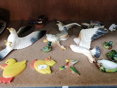 Lot 15-• A collection of ceramic birds.