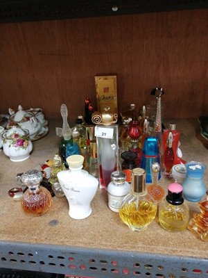 Lot 21-A good collection of perfume bottles.