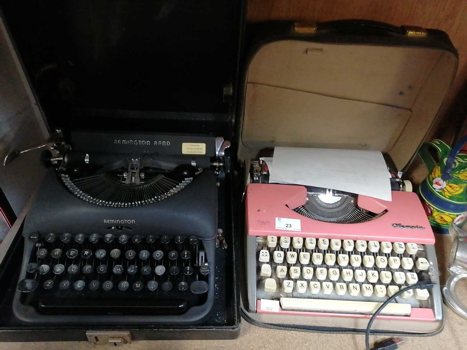 Lot 23-A 'Remington' typewriter and a 'Olympia'...