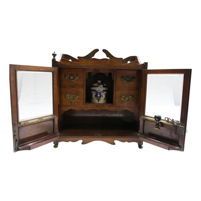 Lot 6-An Edwardian oak smokers cabinet, height 45cm,...