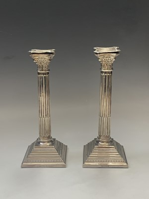 Lot 1056 - A pair of filled silver classical column...